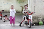 Children playing on tricycles outside, Norland Nursery, Bath. - Paul Box - ,2010s,2012,areas,bicycle,bicycles,BICYCLING,Bicyclist,Bicyclists,BIKE,BIKES,boy,boys,CARE,carer,carers,child,child care,childcare,CHILD-CARE,CHILDHOOD,childminding,children,CRECH,creche,creches,cycle