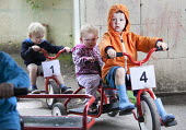 Children playing on tricycles outside, Norland Nursery, Bath. - Paul Box - 27-06-2012