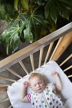A baby sleeping in a cot outside, Norland Nursery, Bath. - Paul Box - 27-06-2012