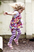 A girl playing outside on a climbing frame, Norland Nursery, Bath. - Paul Box - 27-06-2012