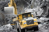 A quarry worker driving a digger at Welsh Slate, Penrhyn quarry, Bethesda, North Wales. - Paul Box - 12-08-2013