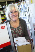 A rural post office opens in Gwilliams garden machinery store, Edington, Somerset - Paul Box - 17-12-2013