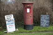 A rural post office opens in Gwilliams garden machinery store, Edington, Somerset - Paul Box - 2010s,2013,box,boxes,EBF,Economic,Economy,film,garden,GARDENS,in,local,MAIL,new,night,pillar box,post,Post Office,Post Office,Postal Service,postbox,public services,ROYAL,royal mail,royal mail,rural,S