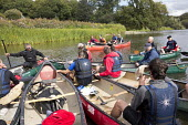 A stag party canoes down the river Teifi, Pembrokeshire, Wales. - Paul Box - 07-09-2013