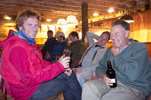 A stag party in a pub in Cardigan, Pembrokeshire, Wales. - Paul Box - 2010s,2013,at,beer,camping,Camping Site,campsite,country,countryside,do,drink,drinker,drinkers,drinking,drinks,ENJOYING,enjoyment,evening,fun,group,groups,having fun,holiday,holiday maker,holiday make