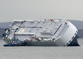 The Hoegh Osaka car carrier aground on Bramble Bank between Southampton and the Isle of Wight after it sailed from the Hampshire port with its cargo of 1,400 cars - Paul Box - 07-01-2015