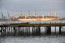 Derelict pier, OOCL Cargo ship Southampton - Paul Box - 2010s,2015,berth,berthed,boat,boats,capitalism,capitalist,cargo,COAST,container,containers,Derelict,DERELICTION,dock,docked,docks,dockside,EBF,Economic,Economy,freight,harbor,harbors,HARBOUR,harbours,