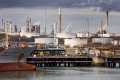 An oil tanker berthed at a terminal, Fawley Refinery, Oil refinery, Southampton Water. - Paul Box - ,2010s,2015,berth,berthed,boat,boats,capitalism,capitalist,cargo,Company,dock,docked,docks,dockside,EBF,Economic,Economy,Esso,export,exports,harbor,harbors,HARBOUR,harbours,import,IMPORTED,imports,Ind