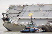 Salvage experts climbing on the ship. The Hoegh Osaka car carrier aground on Bramble Bank between Southampton and the Isle of Wight after it sailed from the Hampshire port with its cargo of 1,400 cars - Paul Box - 07-01-2015