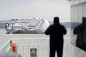 The Hoegh Osaka car carrier aground on Bramble Bank between Southampton and the Isle of Wight after it sailed from the Hampshire port with its cargo of 1,400 cars - Paul Box - 2010s,2015,accident,accidental,accidents,accidents at work,AUTO,auto industry,AUTOMOBILE,AUTOMOBILES,automotive,Bank,BANKS,boat,boats,capitalism,capitalist,car,Car Industry,cargo,carindustry,cars,dia,