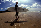 Surfer Bude Beach Cornwall - Paul Box - 2000s,2002,beach,beaches,Blue Sky,board,boards,coast,coastal,coasts,Extreme,Extreme Sports,holiday,holiday maker,holiday makers,holidaymaker,holidaymakers,HOLIDAYS,Kites,LFL leisure,OCEAN,people,perso