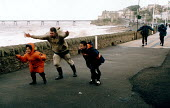 A family struggles aginst storm force winds, Clevedon, near Bristol. - Paul Box - 27-10-2002