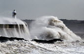 Storm waves smash into the seafront, lighthouse and seawall, Porthcawl, Wales - Paul Box - ,2010s,2014,CLIMATE,Climate Change,coast,coastal,coasts,conditions,costal defences,danger,dangerous,dangers,defence,defense,defenses,degradation,DIA,eni,environment,Environmental,Environmental degrada
