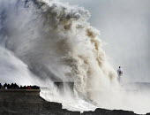 Storm waves smash into the seafront, lighthouse and seawall, Porthcawl, Wales - Paul Box - 08-02-2014