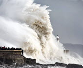 Storm waves smash into the seafront, lighthouse and seawall, Porthcawl, Wales - Paul Box - 2010s,2014,CLIMATE,Climate Change,coast,coastal,coasts,conditions,costal defences,danger,dangerous,dangers,defence,defense,defenses,degradation,DIA,eni,environment,Environmental,Environmental degradat