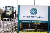 Environment agency pump water from flooded land at Northmoor pumping station, on the Somerset levels. - Paul Box - 2010s,2014,agency,BAD,CLIMATE,Climate Change,conditions,defences,degradation,DIA,eni,Environment,Environment Agency,Environmental,Environmental Issues,EXTREME,flood,Flood Plain,flooded,flooding,floods