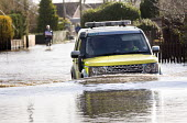 A 4wd Ambulance drives through floodwater at Moorland, on the Somerset levels. - Paul Box - 07-02-2014