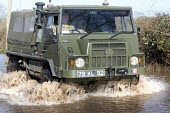 An army vehicle drives through floodwater at Moorland, on the Somerset levels. - Paul Box - 2010s,2014,armed forces,BAD,CLIMATE,Climate Change,closed,closing,closure,closures,conditions,defences,DIA,eni,environment,Environmental Issues,equipment,EXTREME,flood,Flood Plain,Flood Rescue Team,fl