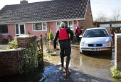 Police walk the streets of Moorland checking on residents, on the Somerset levels. - Paul Box - 2010s,2014,adult,adults,BAD,check,checking,CLIMATE,Climate Change,CLJ,conditions,DIA,eni,environment,Environmental Issues,EXTREME,flood,Flood Plain,Flood Rescue Team,flooded,flooding,floods,force,Glob