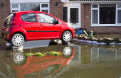 A new car is parked on alloy wheels in an attempt to keep it from the rising flood waters in Moorland on the Somerset levels. - Paul Box - 2010s,2014,AUTO,AUTOMOBILE,AUTOMOBILES,AUTOMOTIVE,BAD,BAG,bags,car,cars,CLIMATE,Climate Change,conditions,defences,DIA,eni,environment,Environmental Issues,EXTREME,flood,Flood Plain,flooded,flooding,f