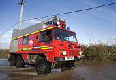 The fire service at Moorland, on the Somerset levels. - Paul Box - 2010s,2014,adult,adults,BAD,CLIMATE,Climate Change,closed,closing,closure,closures,conditions,defences,DIA,eni,environment,Environmental Issues,equipment,EXTREME,fire,Fire and Rescue,fire brigade,Fire