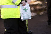 The fire service at Moorland deliver medicine to residents cut off by flood waters on the Somerset levels. - Paul Box - 07-02-2014
