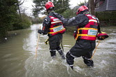 West Midlands Ambulance Service team (Hart) search for residents needing assistance, Wraysbury, Berkshire after the Thames burst its banks. - Paul Box - 12-02-2014
