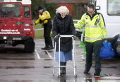 Ambulance workers helping an elderly woman, Wraysbury, Berkshire after the Thames burst its banks. - Paul Box - 12-02-2014