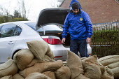 A resident loads his BMW boot with sandbags, Wraysbury, Berkshire after the Thames burst its banks. - Paul Box - 12-02-2014