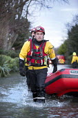 West Midlands Fire service wade through flood waters to check on residents, Wraysbury, Berkshire. - Paul Box - 2010s,2014,adult,adults,BAD,boat,boats,CLIMATE,Climate Change,closed,closing,closure,closures,conditions,DIA,dry,eni,environment,Environmental Issues,EXTREME,fire,Fire and Rescue,fire brigade,fire ser