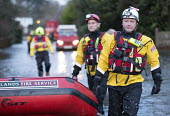 West Midlands Fire service wade through flood waters to check on residents, Wraysbury, Berkshire. - Paul Box - 12-02-2014
