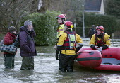 West Midlands Fire service wade through flood waters to check on residents, Wraysbury, Berkshire. - Paul Box - 2010s,2014,adult,adults,BAD,boat,boats,CLIMATE,Climate Change,conditions,DIA,dry,eni,environment,Environmental Issues,EXTREME,fire,Fire and Rescue,fire brigade,fire service,firefighter,firefighters,fi
