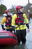 West Midlands Fire service wade through flood waters to check on residents, Wraysbury, Berkshire. - Paul Box - ,2010s,2014,adult,adults,BAD,boat,boats,CLIMATE,Climate Change,closed,closing,closure,closures,conditions,DIA,dry,eni,environment,Environmental Issues,EXTREME,fire,Fire and Rescue,fire brigade,fire se