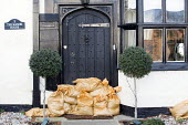 A expensive home has sandbags on its doorstep in Datchet , Berkshire which has been flooded after the Thames burst its banks. - Paul Box - 13-02-2014