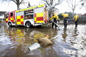 Firefighters pump water from flooded properties in Datchet , Berkshire which has been flooded after the Thames burst its banks. - Paul Box - 13-02-2014