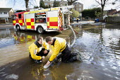 Firefighters pump water from flooded properties in Datchet , Berkshire which has been flooded after the Thames burst its banks. - Paul Box - ,2010s,2014,adult,adults,BAD,berkshire,CLIMATE,Climate Change,conditions,DIA,eni,environment,Environmental Issues,EXTREME,Fire and Rescue,fire brigade,Fire Engine,firefighter,firefighters,fireman,fire