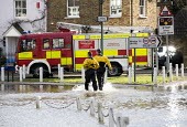 Firefighters pump water from flooded properties in Datchet , Berkshire which has been flooded after the Thames burst its banks. - Paul Box - 2010s,2014,adult,adults,BAD,berkshire,CLIMATE,Climate Change,conditions,DIA,eni,environment,Environmental Issues,EXTREME,Fire and Rescue,fire brigade,Fire Engine,firefighter,firefighters,fireman,firem