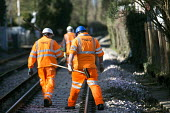 Network rail workers clean up after the railway line flooded in Datchet , Berkshire which has been flooded after the Thames burst its banks. - Paul Box - 2010s,2014,BAD,CLIMATE,Climate Change,conditions,DIA,employee,employees,Employment,eni,environment,Environmental Issues,EXTREME,flood,flooded,flooding,floods,Global Warming,hard hats,incident,incident
