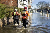 Norfolk fire and rescue service check on residents in Datchet , Berkshire which has been flooded after the river Thames burst its banks. - Paul Box - (HART),2010s,2014,adult,adults,BAD,CLIMATE,Climate Change,conditions,DIA,eni,environment,Environmental Issues,EXTREME,fire AND rescue,fire brigade,Fire Engine,firefighter,firefighters,fireman,firemen,