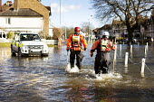 Norfolk fire and rescue service check on residents in Datchet , Berkshire which has been flooded after the river Thames burst its banks. - Paul Box - 13-02-2014