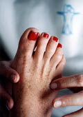 Reflexologist at work - Paul Box - 2000s,2001,age,ageing population,alternative medicine,alternative therapy,complimentary medicine,elderly lady,elderly woman,employee,employees,Employment,feet,feet foot,female,foot,HEA health,healer,h