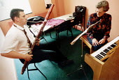 Pupil of Hanham High School, Bristol playing a bassoon in a music lesson - Paul Box - 15-06-2001