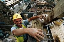 Construction worker measuring. Restoration of Whatley Manor, Malmesbury. Midas construction site - Paul Box - 14-10-2002