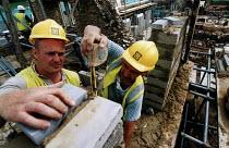 Construction worker measuring. Restoration of Whatley Manor, Malmesbury. Midas construction site. - Paul Box - 14-10-2002