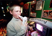 Young teenager measuring lung capacity on a quit smoking display, Weston Super Mare. Organised by Connexions. - Paul Box - 16 year olds,2000s,2002,addiction,adolescence,adolescent,adolescents,blowing into,Cigarette,Cigarettes,communicating,communication,damage,display,displays,hea health,internet,internet website,lung can