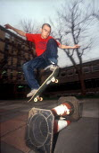 Skateboarder jumping cones, Bristol - Paul Box - 2000s,2002,cones,EXTREME,jumping,lfl Leisure,people,person,persons,skateboard,skateboarder,skateboarders,skateboarding,SKATEBOARDS,SPO sport,sports,urban,young,YOUNGER,youth
