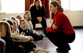 Pupils and teacher during a visit by the Centre for Sustainable Energy. Karren Farris is giving an interactive presentation to promote energy conservation. Whitehouse Primary School Hartcliffe Bristol... - Paul Box - 2000s,2002,assembly,attention,attentive,bright,child,CHILDHOOD,children,cities,city,class,classroom,CLASSROOMS,communicating,communication,Ecological,Ecology,EDU education,energy,engaged,ENI environme