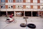 Teenager on a bike playing on Derelict industrial land St Werburghs Bristol - Paul Box - 14-07-2001