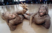 Students covered in the mud, Glastonbury Festival. - Paul Box - 2000s,2001,ACE arts culture & entertainment,EMOTION,EMOTIONAL,EMOTIONS,FEMALE,festival,FESTIVALS,goer,HAPPINESS,happy,hippies,hippy,male,man,melody,muddy,music,MUSICAL,PEOPLE,person,persons,pop,smile,