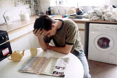 Drinking tea at home in the kitchen. Bristol - Paul Box - 07-11-2001